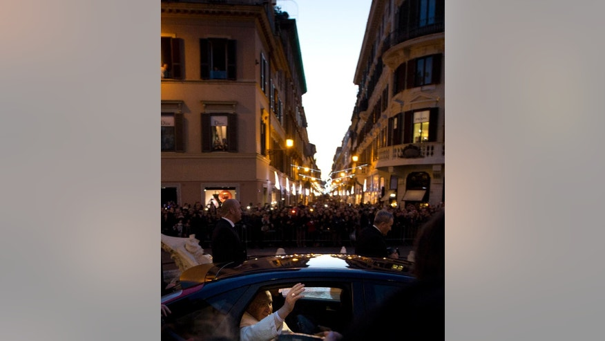 "Pope Francis leaves after he prayed  in front of the statue of the Virgin Mary, on the occasion of the Immaculate Conception feast, in Rome, Monday, Dec. 8, 2014. Pope Francis has prayed that humanity be freed of ""slavery"" to material things as he visited Rome's swank shopping area near the Spanish Steps. Shoppers crowded into the square Monday to see Francis keep an annual appointment that marks both the Dec. 8 Catholic feast day honoring the Virgin Mary and the traditional start of the city's holiday shopping season. (AP Photo/Alessandra Tarantino)"