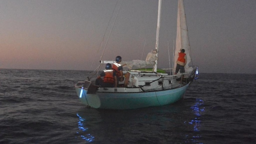 In this Tuesday, Dec. 9, 2014 photo provided by the U.S. Coast Guard, a mariner and his 25-foot sailing vessel are towed to Molokai, Hawaii, after spending 12 days lost at sea. Ron Ingraham was found dehydrated and hungry Tuesday after going missing on Thanksgiving, when the Coast Guard picked up his mayday call saying his boat was in danger of sinking. (AP Photo/U.S. Coast Guard)