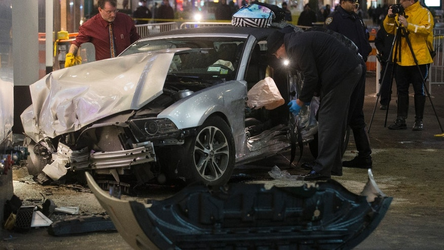 Dec. 11, 2014: Police search a car at the scene of a vehicular accident on 34th Street.