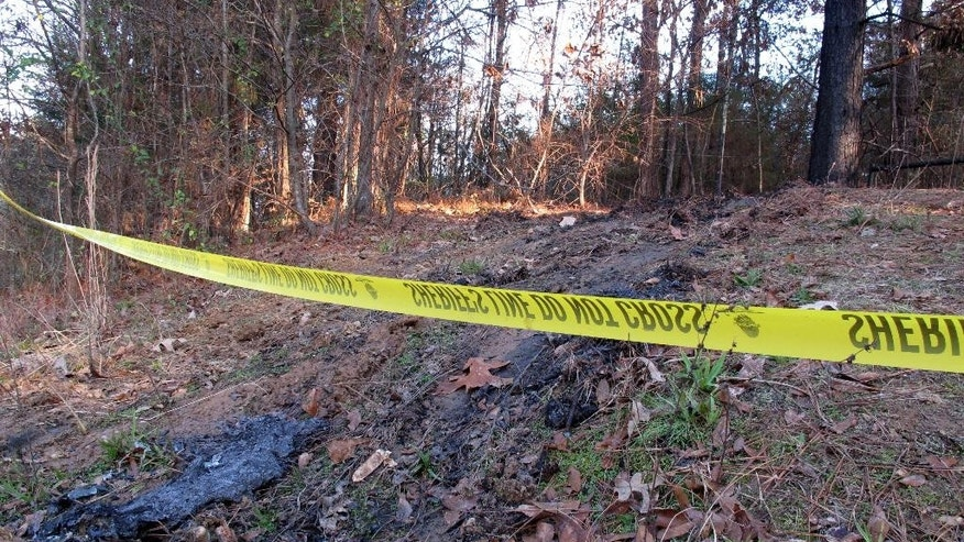 Yellow crime scene tape marks the location where 19-year-old Jessica Chambers was found severely burned, Wednesday, Dec. 10, 2014 in Courtland, Miss. Chambers died Saturday after she was taken to a Memphis hospital with severe burns. Authorities are working to piece together the last hours of her life in efforts to catch who set her on fire. (AP Photo/Adrian Sainz)