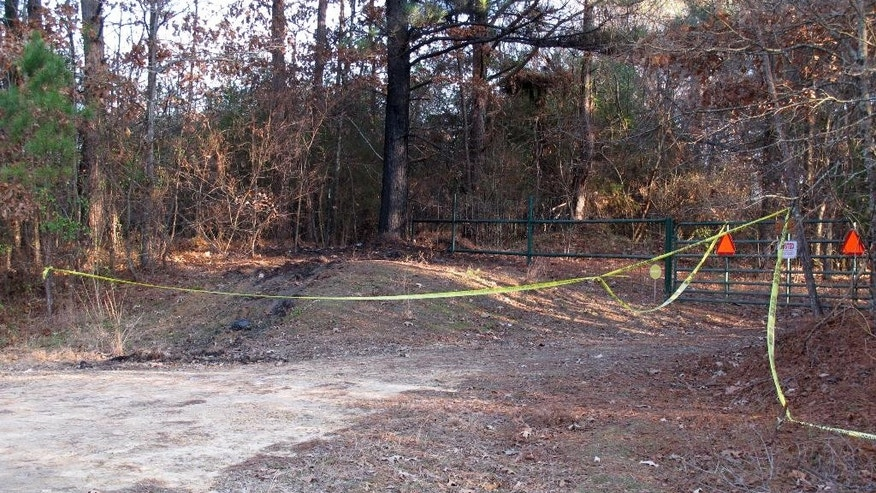 Yellow crime scene tape marks the location where 19-year-old Jessica Chambers was found severely burned, Wednesday, Dec. 10, 2014, in Courtland, Miss. Chambers died Saturday after she was taken to a Memphis hospital with severe burns. Authorities are working to piece together the last hours of her life in efforts to catch who set her on fire. (AP Photo/Adrian Sainz).