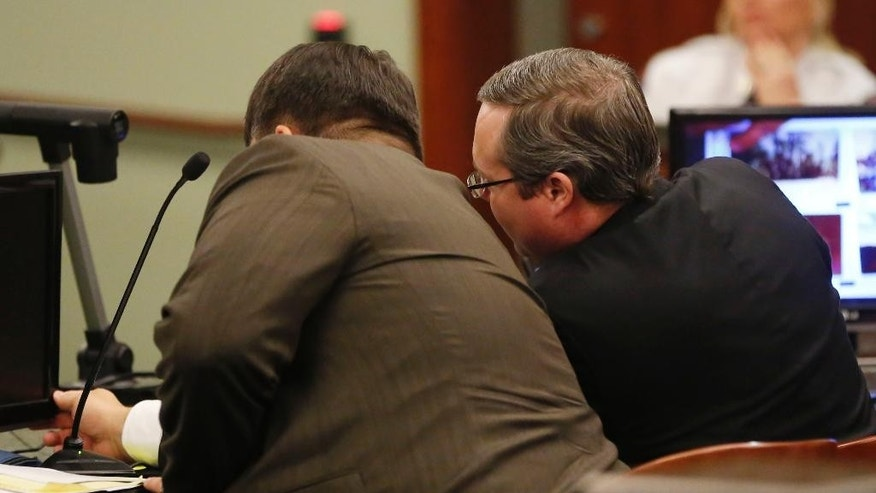 Eric Williams, left, talks with defense lawyer Maxwell Peck during the punishment phase of his capital murder trial at the Rockwall County Courthouse in Rockwall, Texas, on Thursday, Dec. 11, 2014. Williams is accused in the Kaufman DA murder of Mike McLelland and his wife Cynthia McLelland back in 2013. Jurors heard testimony Thursday as they decided whether 47-year-old Eric Williams should be executed or spend the rest of his life in prison. (AP Photo/The Dallas Morning News, Vernon Bryant, Pool)