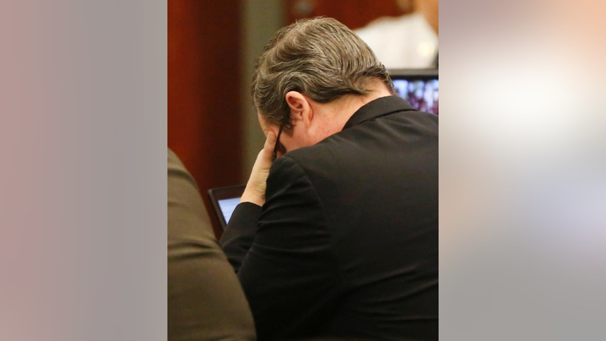 Eric Williams, puts his head in his hands during the punishment phase of his capital murder trial at the Rockwall County Courthouse in Rockwall, Texas, on Thursday, Dec. 11, 2014. Williams is accused in the Kaufman DA murder of Mike McLelland and his wife Cynthia McLelland back in 2013. Jurors heard testimony Thursday as they decided whether 47-year-old Eric Williams should be executed or spend the rest of his life in prison. (AP Photo/The Dallas Morning News, Vernon Bryant, Pool)
