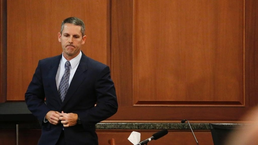 Ian Lyles, cousin to Eric Williams exits the witness stand after giving testimony about Williams during the punishment phase of his capital murder trial at the Rockwall County Courthouse in Rockwall, Texas, on Thursday, Dec. 11, 2014. Williams is accused in the Kaufman DA murder of Mike McLelland and his wife Cynthia McLelland back in 2013. Jurors heard testimony Thursday as they decided whether 47-year-old Eric Williams should be executed or spend the rest of his life in prison. (AP Photo/The Dallas Morning News, Vernon Bryant, Pool)