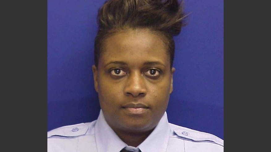 In this undated photo provided by the Philadelphia Fire Department, firefighter Joyce Craig Lewis is shown. Craig Lewis, an eleven-year veteran is the first female member of the department killed in the line of duty. She died after being trapped in the basement of a burning row home on Tuesday, Dec. 9, 2014.  (AP Photo/Philadelphia Fire Department)