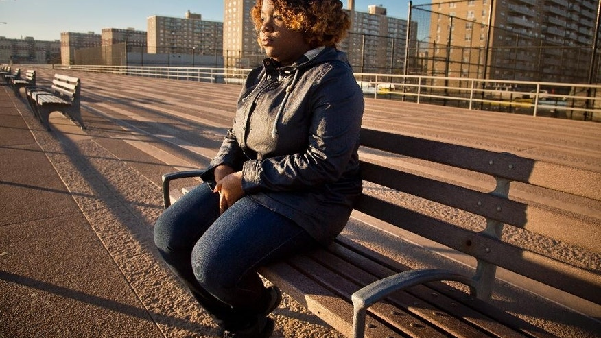 "Buffalo State College senior Katherine Middleton, sits on a boardwalk near her home as she talks about the ""Yes Means Yes"" standard during winter-break, Friday, Dec. 12, 2014, in New York.  A universal ""affirmative consent"" standard is now part of a sexual assault prevention policy adopted across the state's public university system, spelling out for students that only ""yes"" not silence or a lack of resistance,is the cue for sexual activity.  Middleton says the ""Yes Means Yes"" standard that is now part of a sexual assault prevention policy adopted across the state's public university system SUNY, ""makes it almost seem more like a business deal than an act that happens.""  (AP Photo/Bebeto Matthews)"