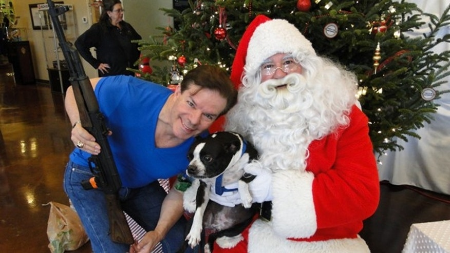 "Dec. 13, 2014: Neal Arnold from Buckhead poses with Santa and his dog. ""I plan on putting my picture on a Christmas card,"" he said. ""I've never had one with me and my dog and Santa before."" (Photo courtesy Sandy Springs Gun Club)"