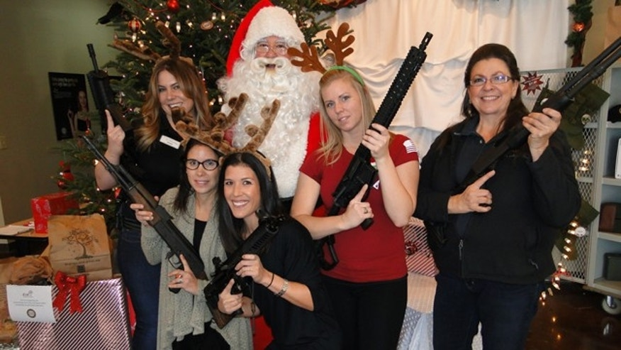 Dec. 13, 2014: Sandy Springs Gun Club co-owners Cara Workman and Robyn Workman Marzullo pose with Santa and other staff. (Photo Courtesy Sandy Springs Gun Club)