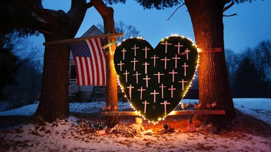 Dec. 14, 2013: In this file photo, a makeshift memorial with crosses for the victims of the Sandy Hook Elementary School shooting massacre stands outside a home in Newtown, Conn., on the one-year anniversary of the shootings. (AP)