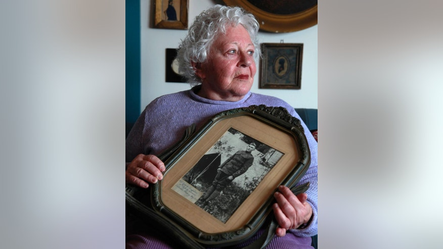 FILE - In this Jan. 5, 2012 file photo Elsie Shemin-Roth holds a World War I photo of her father William Shemin at her home in Labadie, Mo. Nearly a century ago, Sgt. Shemin raced across a battlefield three times to pull wounded comrades to safety, survived a bullet to the head and led his unit to safety. The heroism should have earned him the Medal of Honor but didn't, possibly because discrimination was rampant _ and he was Jewish. Thanks to the efforts of his daughter, Shemin is on the cusp of finally being honored with a medal, 41 years after his death. (AP Photo/Jeff Roberson, File)