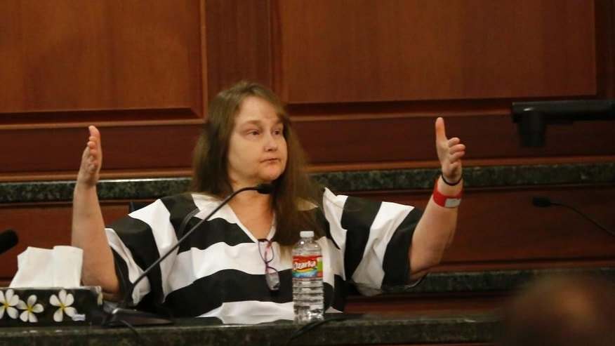 Kim Williams, the estranged wife of Eric Williams, testifies during the punishment phase of the Eric Williams trial at the Rockwall County Courthouse in Rockwall, Texas, Tuesday, Dec. 16, 2014. Williams was convicted Dec. 4 in the shooting death of Cynthia McLelland. He is also charged, but has not been tried, in the deaths of Kaufman County District Attorney Mike McLelland and assistant prosecutor Mark Hasse.   (AP Photo/The Dallas Morning News, Vernon Bryant, Pool)