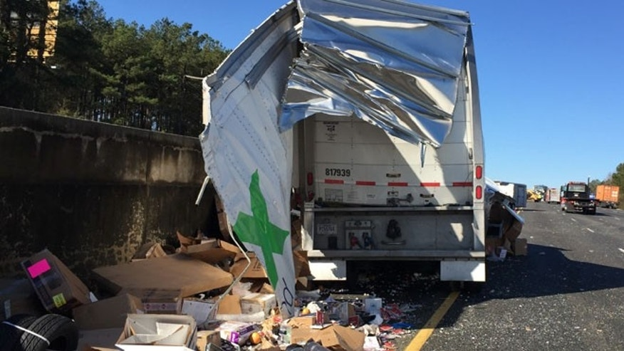 Dec. 16, 2014: Packages litter the shoulder of Interstate 75 after a FedEx truck crashed Tuesday morning in Forsyth, Ga.