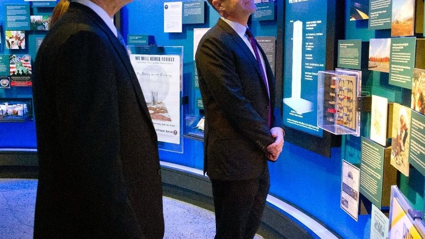 In this photo taken on Sunday, Dec. 14, 2014, and provided by the National September 11 Memorial and Museum, former President George W. Bush, left, views exhibits with National September 11 Memorial & Museum President Joe Daniels during an unannounced visit to the National September 11 Memorial & Museum in New York.  (AP Photo/National September 11 Memorial & Museum, Jin Lee)