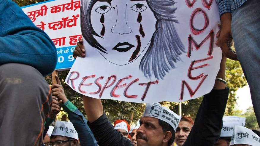 Dec. 8, 2014: Supporters of Aam Aadmi (Common Man) Party (AAP) hold placards during a protest after a woman was allegedly raped by a driver from ride-booking service Uber in New Delhi, India.