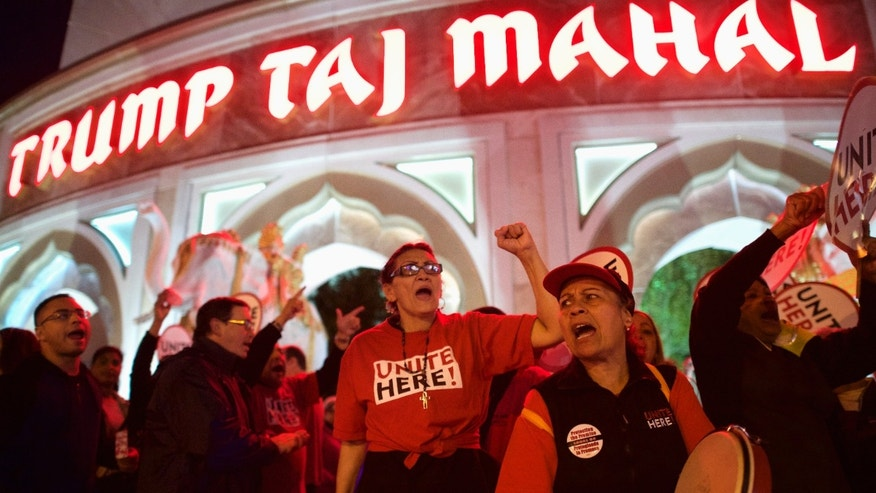 Oct. 24, 2014: Marita Luna (C) and Miriam Ramos (2nd R) joins other union members from UNITE HERE Local 54 as they rally outside the Trump Taj Mahal Casino in Atlantic City,