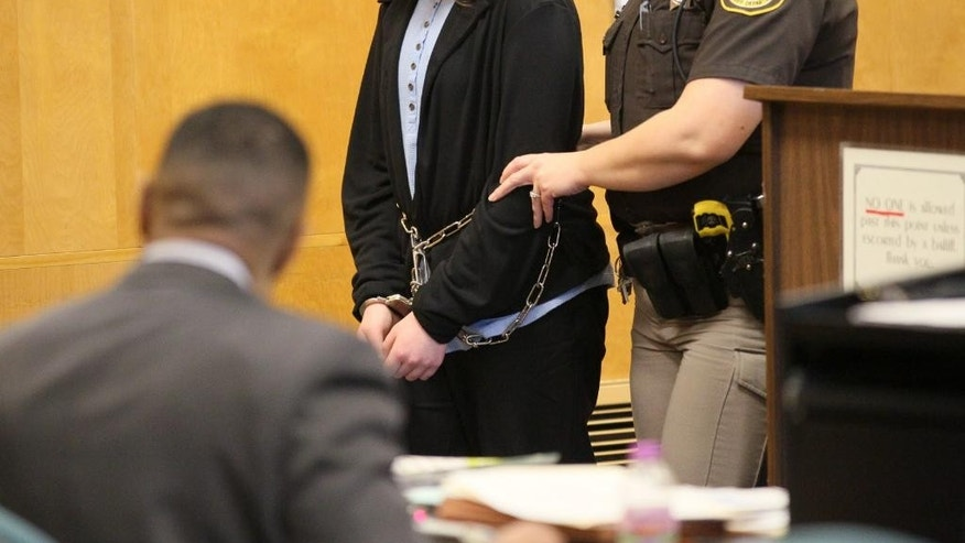One of the two 12-year-old defendants is led into the courtroom in Waukesha, Wis. on Thursday, Dec. 18, 2014 during the trial for the stabbing of a third girl in May 2014. The two girls told detectives the attack was an attempt to please Slenderman, a fictional character they found on a horror website. (AP Photo/Milwaukee Journal-Sentinel, Michael Sears, Pool)