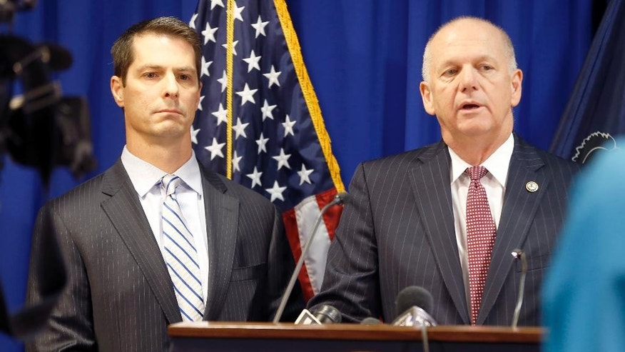 U.S. Attorney David Hickton, right, and Eric Zahren, the special agent-in-charge of Pittsburgh's U.S. Secret Service office, talk about the investigation and arrest of Ryan Andrew Gustafson, during a news conference ,Thursday, Dec. 18, 2014, in Pittsburgh. Gustafson has been charged with leading an international counterfeit money operation based in the African nation of Uganda, and shipping bogus bills to the Pittsburgh area and other locations in the United States. (AP Photo/Keith Srakocic)