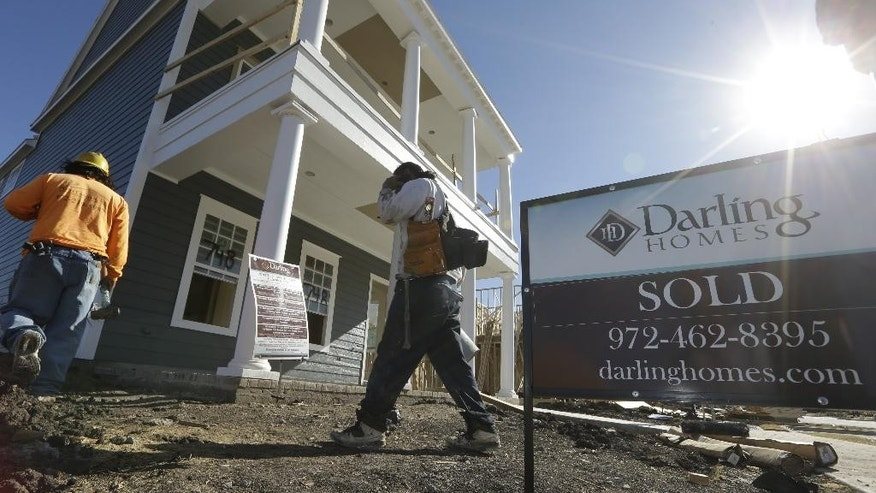 In this Monday, Dec. 15, 2014 photo, workers return from a lunch break to a subdivision under construction in Coppell, Texas. The Conference Board releases leading indicators for November on Thursday, Dec. 18, 2014. (AP Photo/LM Otero)