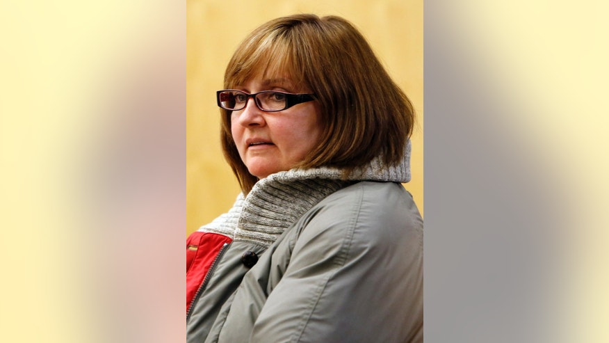 Former family practice doctor, Genevieve Kelley arrives for a hearing in Coos County Superior Court in Lancaster, N.H. Thursday Dec. 18, 2014. Kelley is charged with fleeing the country with her young daughter, now 18,  during a custody dispute 10 years ago.  Kelley, turned herself in to face a custodial interference charge. Authorities still don't know where her daughter is.  (AP Photo/Jim Cole)