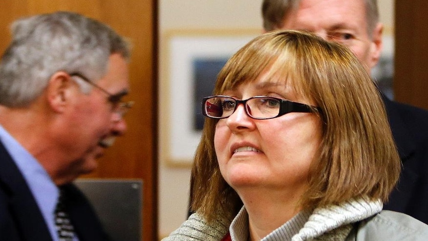 Former family practice doctor, Genevieve Kelley arrives for a hearing in Coos County Superior Court in Lancaster, N.H. Thursday, Dec. 18, 2014. Kelley is charged with fleeing the country with her young daughter, now 18, during a custody dispute 10 years ago.  Kelley, turned herself in to face a custodial interference charge. Authorities still don't know where her daughter is.(AP Photo/Jim Cole)
