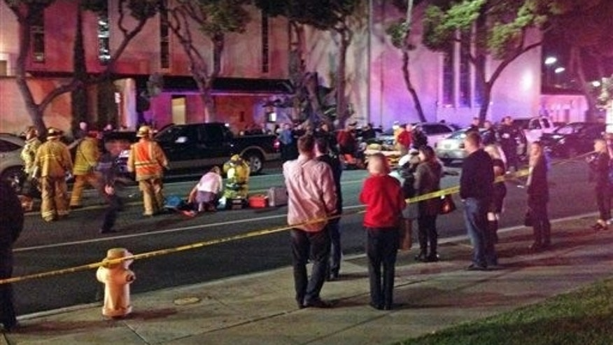 Dec. 17: In this photo provided by Mark Milutin, firefighters work on a victim at left after a driver suspected of being intoxicated hit a group of pedestrians and another car outside a church as a Christmas service ended in the Los Angeles suburb of Redondo Beach, Calif.