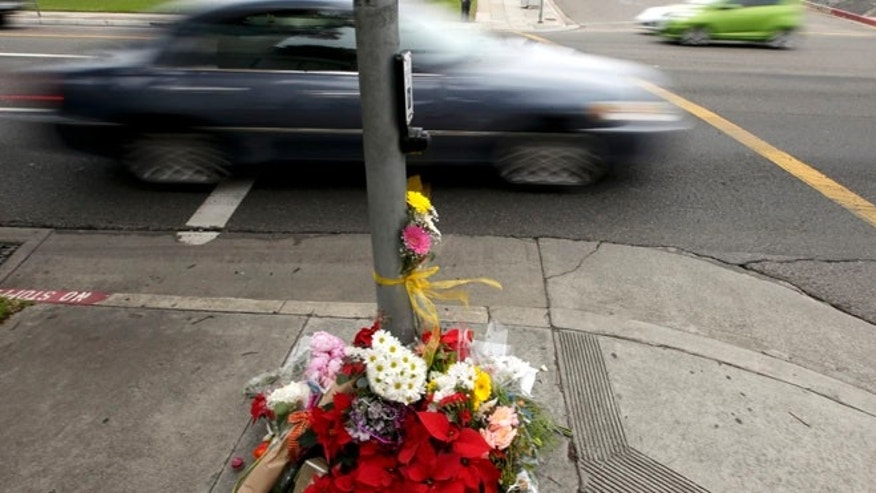 Dec. 18, 2014: Mourners placed flowers at a make shift memorial near where a driver suspected of being intoxicated hit a group of pedestrians and another car outside a church as a Christmas service ended Wednesday night in Redondo Beach, Calif. (AP)
