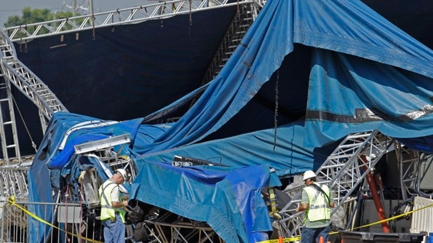 Aug. 17, 2011: investigators examine the stage that collapsed on Saturday at the Indiana State Fair in Indianapolis.
