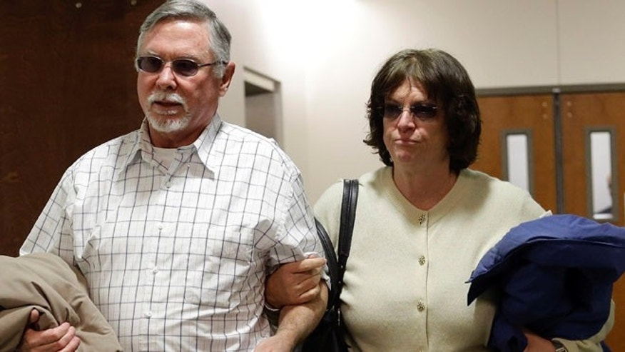 March 12, 2013: In this file photo, Robert and Arlene Holmes, the parents of Aurora theater shooting suspect James Holmes, arrive at district court for the arraignment of their son in Centennial, Colo. (AP)