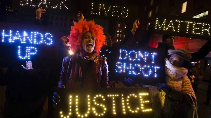 Dec. 13, 2014:  Demonstrator chants during a rally in downtown Manhattan in New York