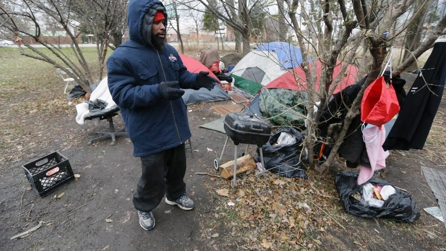 Dec. 17, 2014: Charles Floyd Jones picks up trash at the tent city on the eastern edge of downtown Detroit. (AP)