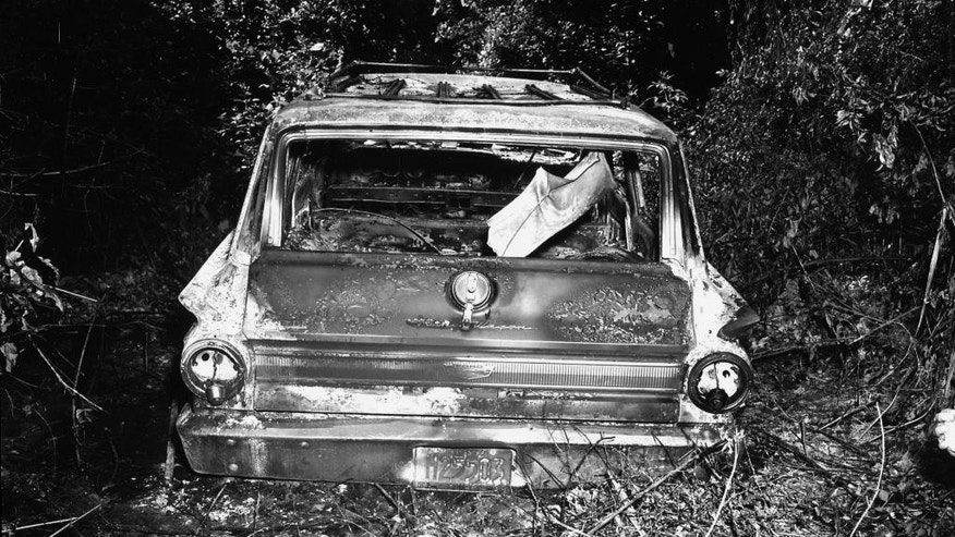 File-This June 1964 FBI photograph presented into evidence, Friday, June 17, 2005, in Philadelphia, Miss., during the trial of Edgar Ray Killen, who is charged with the 1964 deaths of three civil rights workers. The photograph shows the burned station wagon driven by James Chaney, Andrew Goodman and Mickey Schwerner was found shortly after their disappearance. The car was discovered at the Bogue Chitto swamp some 13 miles northeast of Philadelphia.   (AP Photo/State of Mississippi, Attorney General's Office, File)