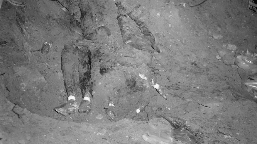 FILE - In this 1964 file photo released by the FBI, the bodies of three civil rights workers are uncovered from an earthen dam southwest of Philadelphia, Miss. The photograph was entered as evidence by the prosecution in the trial of Edgar Ray Killen, who was convicted in 2005 for three counts of manslaughter in the deaths of James Chaney, Andrew Goodman and Michael Schwerner. (AP Photo/FBI, File)