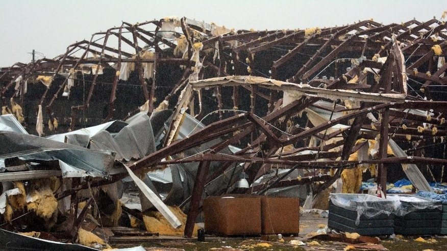 A building is severely damaged on US 98 East near Columbia, Miss., after a tornado touched down Tuesday, Dec. 23, 2014. According to Marion County Emergency Management the tornado touched down around 2:30 p.m. (AP Photo/The Hattiesburg American, Eli Baylis)