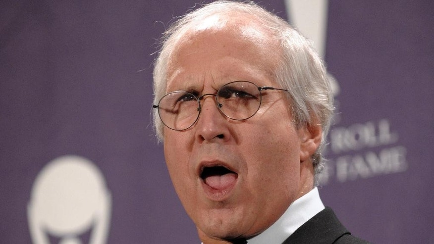"FILE - In this March 10, 2008, file photo, actor Chevy Chase poses backstage at the Rock and Roll Hall of Fame Induction Ceremony, in New York.  On Thursday, Dec. 25, 2014, a sign for an exit on New Jersey's Garden State Parkway for Clark and Westfield to read ""Clark Griswold,"" after a character played by Chevy Chase in the Christmas cult classic, 'Christmas Vacation.' (AP Photo/Evan Agostini, File)"
