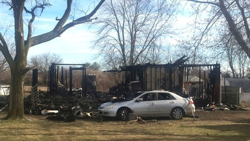 Dec. 26, 2014: The scene of a house where a grandmother and her three grandchildren were killed in a fire in Fayette County, Ohio.