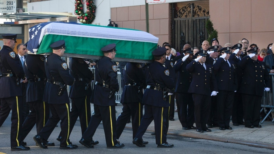 Dec. 26, 2014: The casket of New York Police Department officer Rafael Ramos arrives to his wake at Christ Tabernacle Church in the Glendale section of Queens
