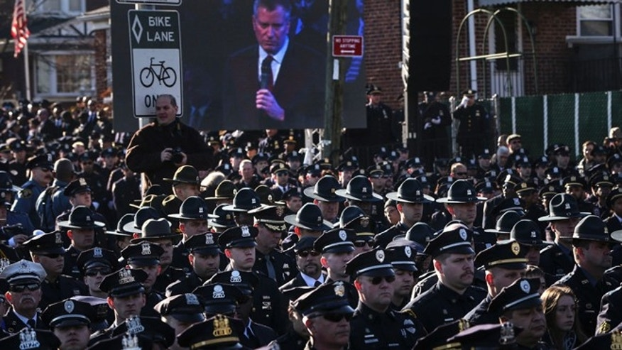 Dec. 27: Law enforcement officers turn their backs on a live video monitor showing New York City Mayor Bill de Blasio as he speaks at the funeral of slain New York Police Department officer Rafael Ramos near Christ Tabernacle Church in the Queens.