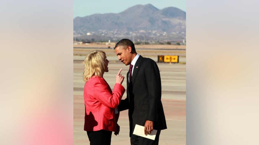 FILE - In this Jan. 25, 2012, file photo, Arizona Gov. Jan Brewer points at President Barack Obama after he arrived at Phoenix-Mesa Gateway Airport, in Mesa, Ariz. Brewer fought Obama on immigration and border security for most of her tenure, earning national prominence by enacting tough laws that were mainly struck down by the courts and famously wagging her finger in the president's face during a meeting on the airport tarmac. But the Republican governor leaves a more nuanced legacy after nearly six years in office, one that saw her inherit a massive deficit at the height of the Great Recession, patch it up and push for economic recovery only to see Arizona sink back into a deficit as she prepares to step down Jan. 5,  2015. (AP Photo/Haraz N. Ghanbari, File)