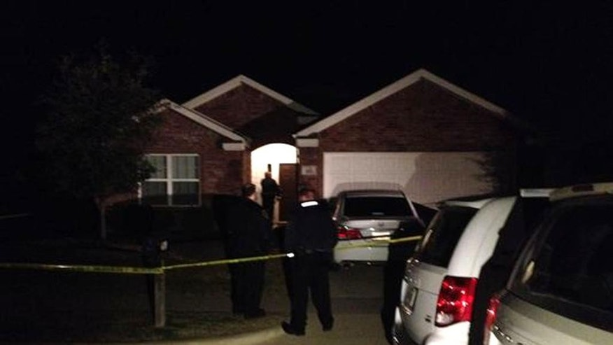 This image provided by WFAA-TV shows the scene outside of a home in Crowley,Texas, Sunday, Dec. 28, 2014, where officers responding to a report of a suicide attempt found four people dead inside, according to police. Authorities are still investigating. (AP Photo/WFAA-TV.com) MANDATORY CREDIT