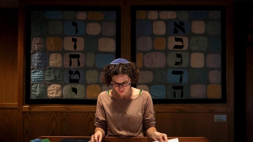 In this Sept. 12, 2014 photo, student rabbi Sara Eiser, visiting from rabbinical school in Cincinnati, Ohio, goes over her notes before shabbat service at the Synagogue of the Black Hills in Rapid City, S.D. South Dakota's first Jewish congregation was established in Deadwood more than 150 years ago during the Gold Rush. Today, fewer than 400 people make up the Jewish community in this sparsely populated state of about 845,000 residents.  (AP Photo/Kristina Barker)