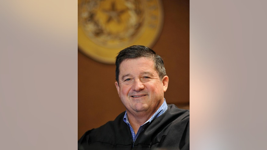 "Dib Waldrip, Comal County, Texas, 433rd District Court judge, is photographed Tuesday, Dec. 9, 2014, in New Braunfels, Texas. Indigent defendants in Comal County, between Austin and San Antonio, will be able to choose a defense attorney from a list to 30 to 50 names pre-approved by the court.  Waltrip said he's unsure simply ""throwing money"" at indigent defense will fix its problems and is looking forward to finding out if attorney choice can make courts more efficient.  (AP Photo/Darren Abate)"