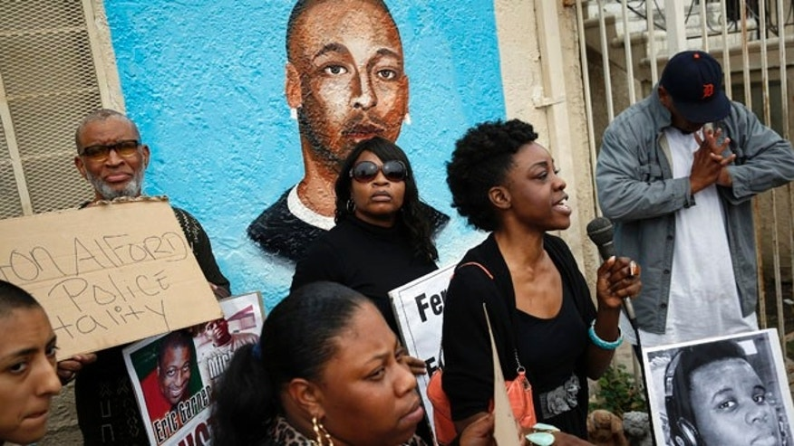 Dec. 1, 2014: Demonstrators rally against the Missouri grand jury's decision to not indict Darren Wilson for his fatal shooting of Michael Brown, in front of a mural of Ezell Ford, on the corner of Broadway and 65th Street in Los Angeles.