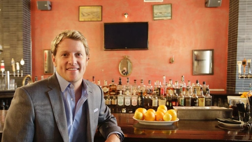 In this Dec. 16, 2014 photo, Jayson Seaver poses for a photo in New York's Harding's restaurant, of which he is a part owner. Seaver feels the wealth gap has affected his relationship with his sister. (AP Photo/Mark Lennihan)
