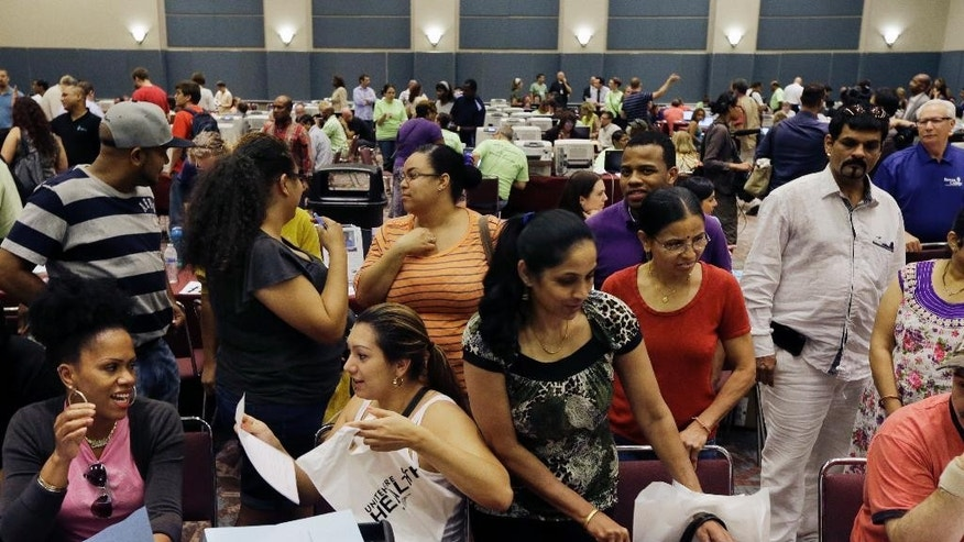 FILE - In this Sept. 3, 2014, file photo, people sign up for unemployment and other benefits in Atlantic City, N.J. The U.S. Labor Department reports on the number of people who applied for unemployment benefits during the last full week of 2014, on Wednesday, Dec. 31, 2014. (AP Photo/Mel Evans, File)