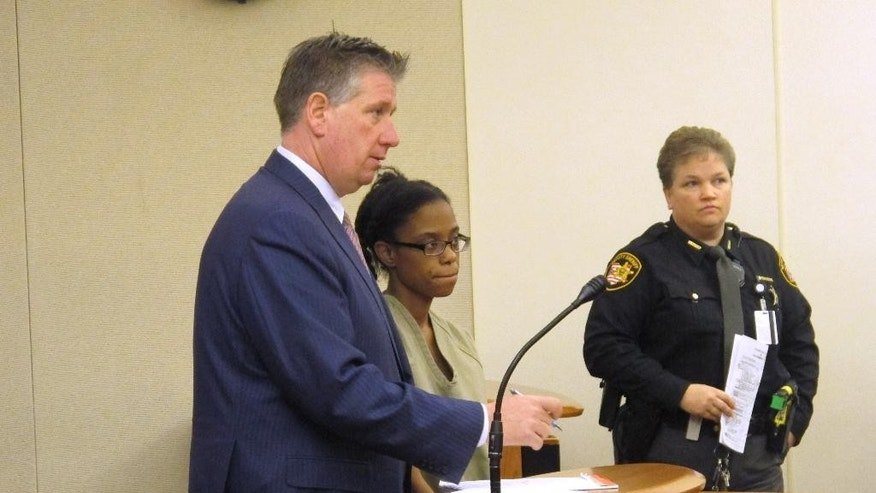 Dainesha Stevens, center, listens during a court appearance where a judge sent a $150,000 bond on endangering children and tampering evidence charges, as her lawyer, Mark Collins, left, answers a question, on Wednesday, Dec. 31, 2014, in Columbus, Ohio. The charges are related to the disappearance of Stevens' 14-month-old son, Cameron Beckford, whose body was found in a creek Wednesday. (AP Photo/Andrew Welsh-Huggins)