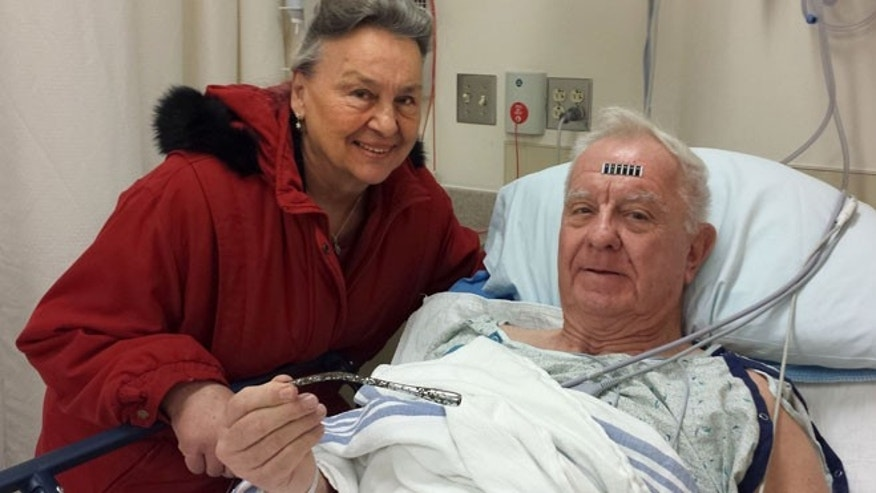 Dec. 31: Arthur Lampitt and his wife Betty of Granite City, Mo., show off the 1963 Thunderbird turn signal that was embedded in his arm for 51 years, after having surgery to remove it.