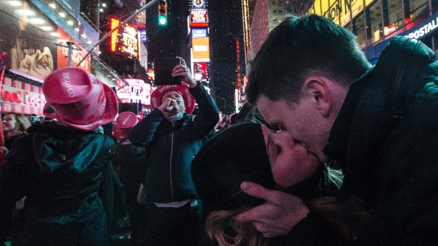 Jan. 1, 2015: Sean Reilly and Emily Verselin share a kiss at midnight in Times Square during a New Year's Eve celebration