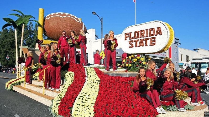 The Florida State float moves down Colorado Boulevard during the 126th Rose Parade in Pasadena, Calif., Thursday, Jan. 1, 2015. Florida State played Oregon later Thursday in the Rose Bowl. (AP Photo/Ringo H.W. Chiu)