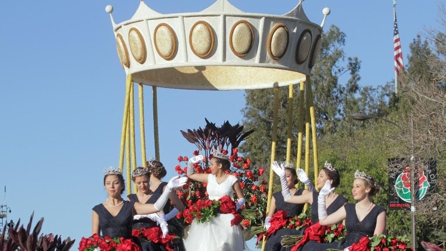The Rose queen and court wave from a float during the 126th Rose Parade in Pasadena, Calif., Thursday, Jan. 1, 2015. From lower left are Princesses Emily Alicia Olivas Stoker, Veronica Sara Mejia and Mackenzie Joy Byers, Queen Madison Elaine Triplett, and Princesses Gabrielle Ann Current, Simona K. Shao and Bergen Louie Onufer. (AP Photo/Ringo H.W. Chiu)