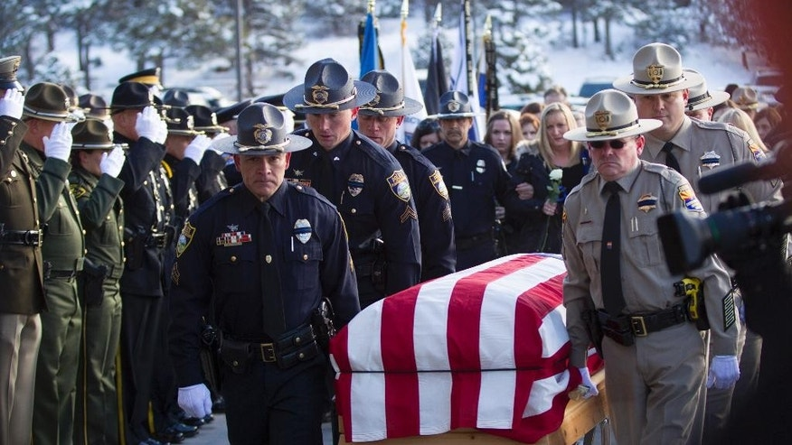 The family of fallen officer Tyler Stewart follows his coffin into Christ's Church of Flagstaff, Friday, Jan. 2, 2015 in Flagstaff, Ariz. Hundreds gathered Friday for a funeral service honoring Stewart, a Flagstaff police officer fatally shot by a domestic violence suspect. (AP Photo/The Arizona Republic, Patrick Breen)  MARICOPA COUNTY OUT; MAGS OUT; NO SALES